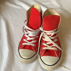 Very bright red converse